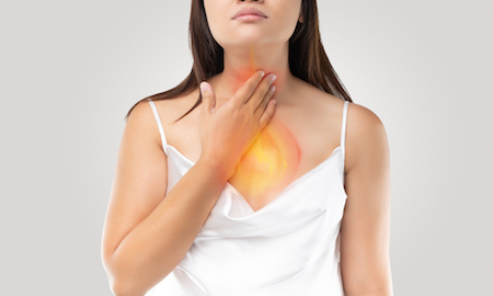 A,Woman,Suffering,From,Acid,Reflux,Or,Heartburn,On,Gray